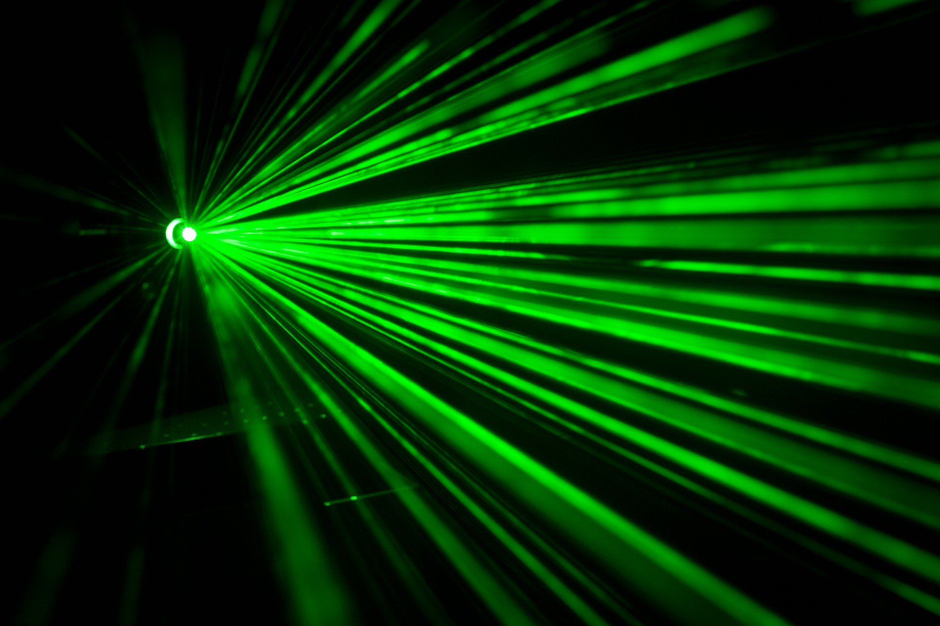 Image of several green lazer beams shining towards the camera. LED therapy available at the Karlfeldt Center of Meridian, Idaho.