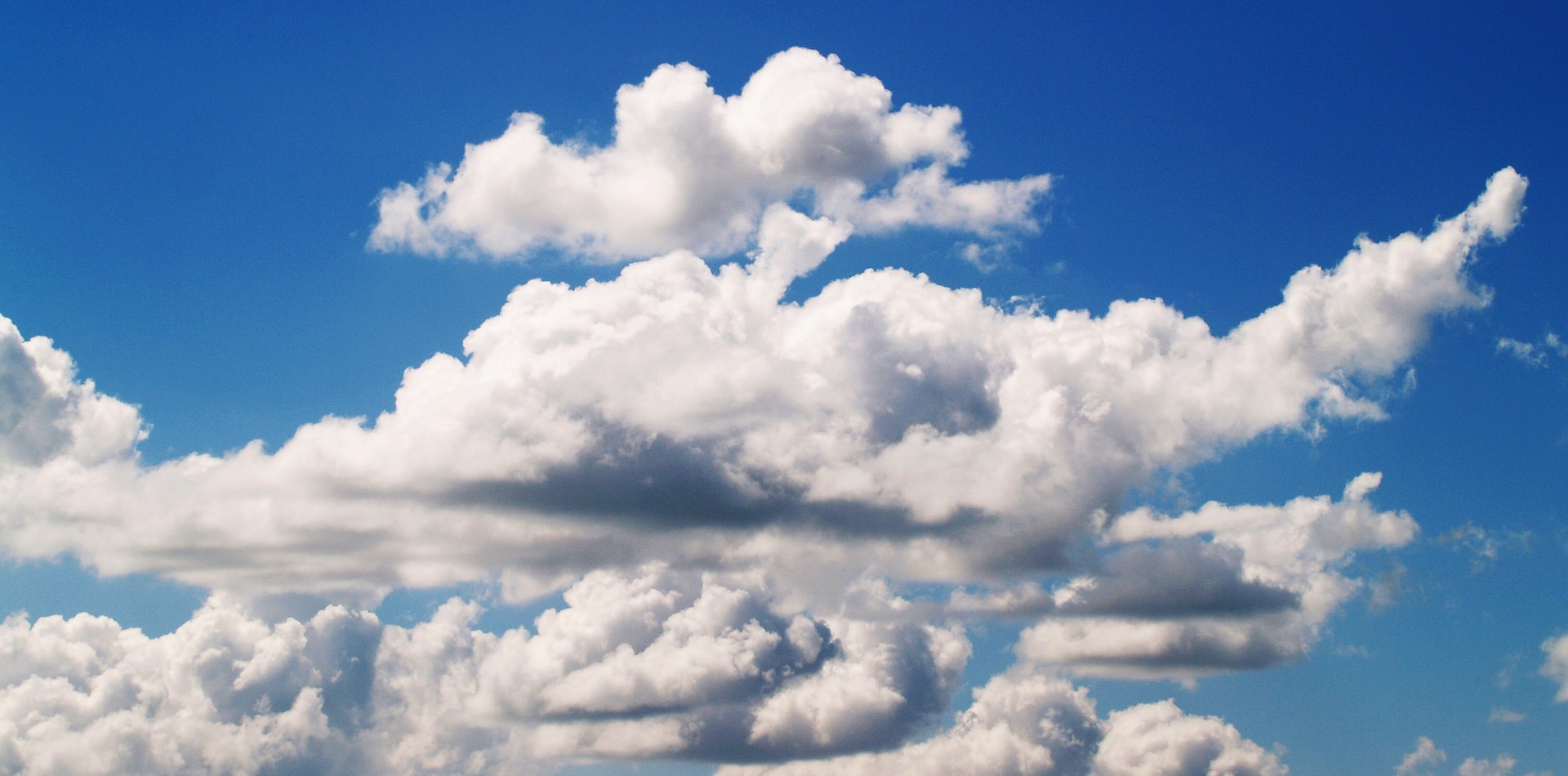 Image is a blue sky with clouds spread across. Ozone Therapy is provided by The Karlfeldt Center of Idaho.